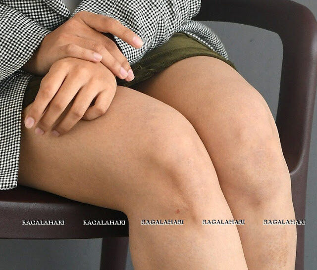Malavika Nair naked thigh clean shaved and waxed leg in mini skirt
